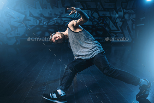 Breakdance performer posing in dance studio - Stock Photo - Images