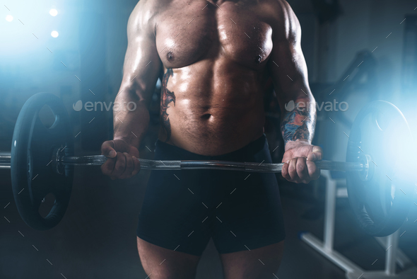 Strong athlete lifting the barbell in sport gym - Stock Photo - Images