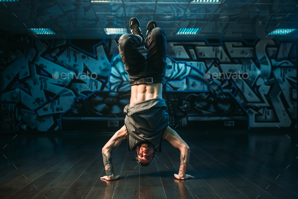 Young breakdance performer, upside down motion - Stock Photo - Images