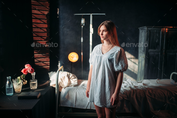 Ill woman in hospital, drip and bed on background - Stock Photo - Images