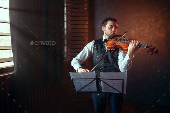 Male violinist playing classical music on violin - Stock Photo - Images