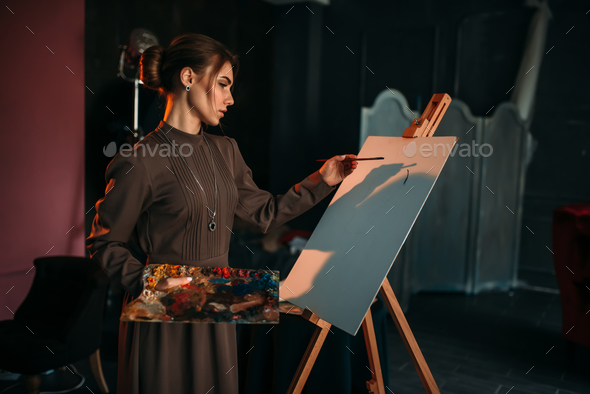 Female painter with brush and palette in hands - Stock Photo - Images