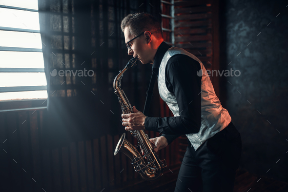 Saxophonist playing jazz melody on saxophone - Stock Photo - Images