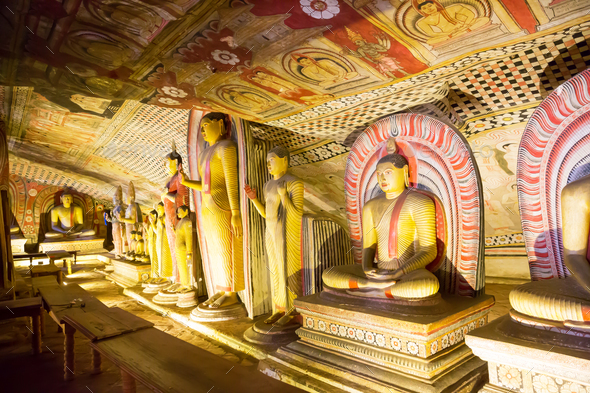 Ancient golden statues in buddha temple on Ceylon - Stock Photo - Images