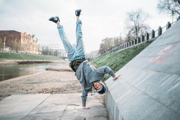 Hip hop performer, upside down motion on street - Stock Photo - Images