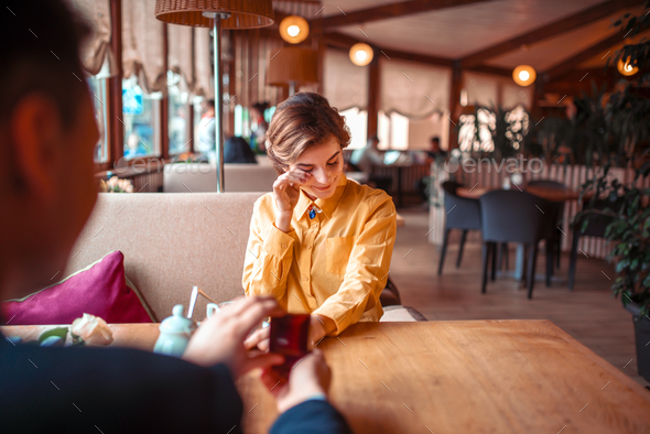 Marriage proposal with wedding ring at restaurant - Stock Photo - Images