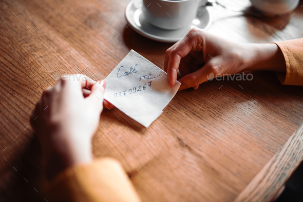 Female person hands holds love note - Stock Photo - Images