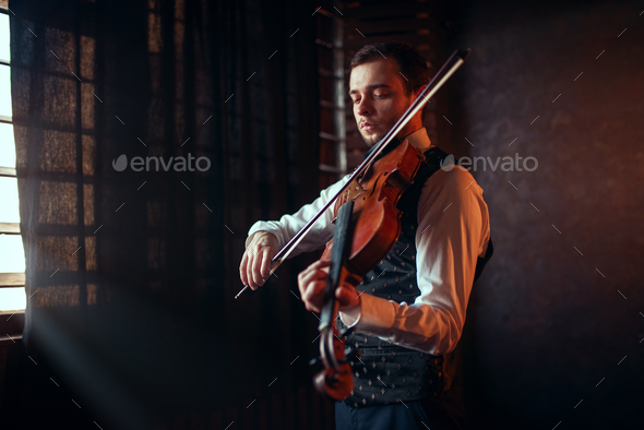 Male fiddler playing classical music on violin - Stock Photo - Images