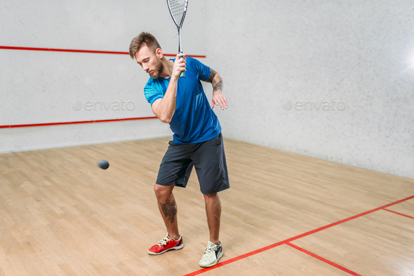 Squash game training, male player with racket - Stock Photo - Images