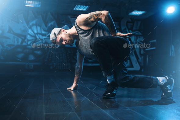 Breakdance motions, performer in dance studio - Stock Photo - Images