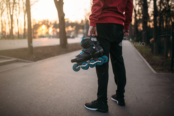 Male person hands with roller skates - Stock Photo - Images