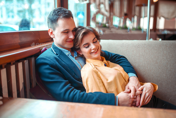 CHeerful love couple at romantic date - Stock Photo - Images