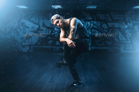 Young male hip hop dancer posing in dance studio - Stock Photo - Images