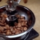 Coffee Beans Fall in the Old Grinder
