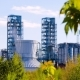Oil Refinery with Green Leaves in the Foreground - VideoHive Item for Sale