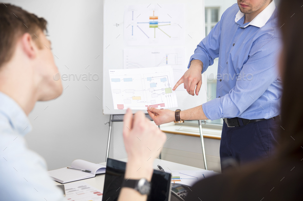 Professional Showing Chart To Colleagues In Office - Stock Photo - Images