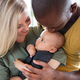 Download Young interracial family with little baby son at home. from PhotoDune