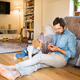 Young father with smartphone and his little son at home - PhotoDune Item for Sale