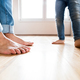 Beautiful young family. Bare feet of father and daughter. - PhotoDune Item for Sale