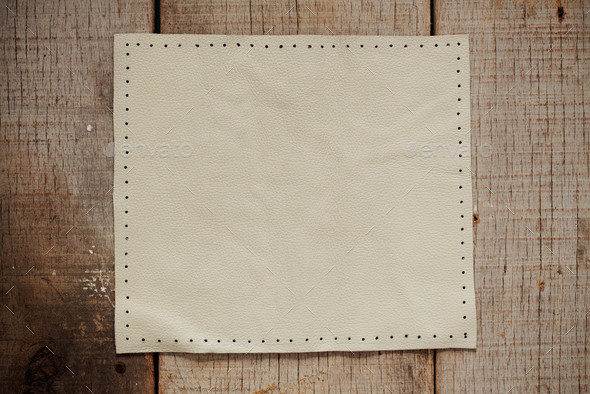 White leather on wooden - Stock Photo - Images