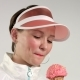 Sport Style Woman Eats Ice Cream and Smiling