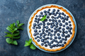 Delicious dessert blueberry tart with fresh berries and whipped cream, sweet tasty cheesecake
