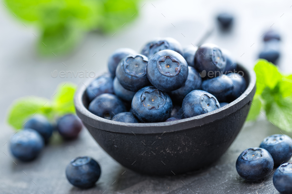Fresh Blueberries in a bowl on dark background, top view  Juicy wild forest  berries, bilberries