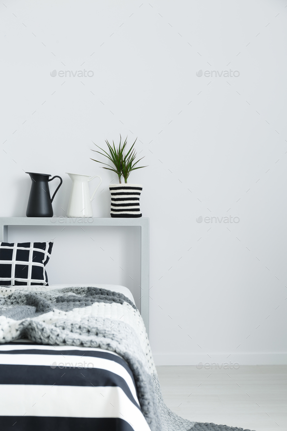 Bed with blanket and decorations - Stock Photo - Images