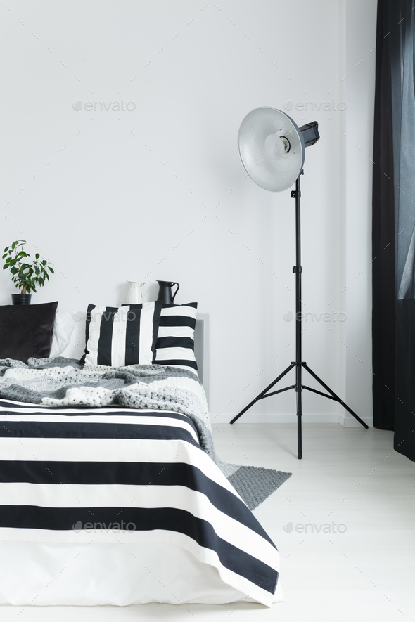 Bed with bedding and lamp - Stock Photo - Images
