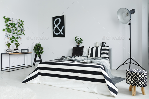 Bedroom with plants and lamp - Stock Photo - Images