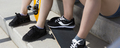 Teenagers legs in sport shoes