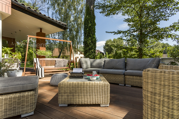 Cozy terrace with wicker furniture - Stock Photo - Images