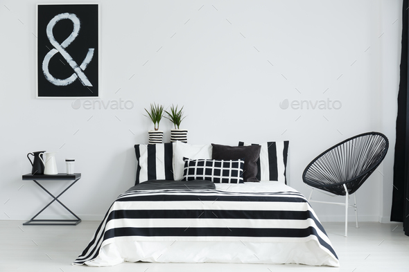 Bedroom with chair and table - Stock Photo - Images