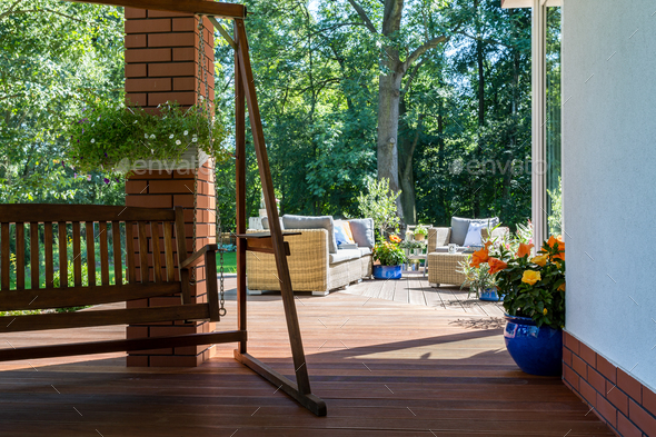 Garden swing and a cozy terrace - Stock Photo - Images