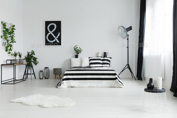 Bedroom with rug and decorations - Stock Photo - Images