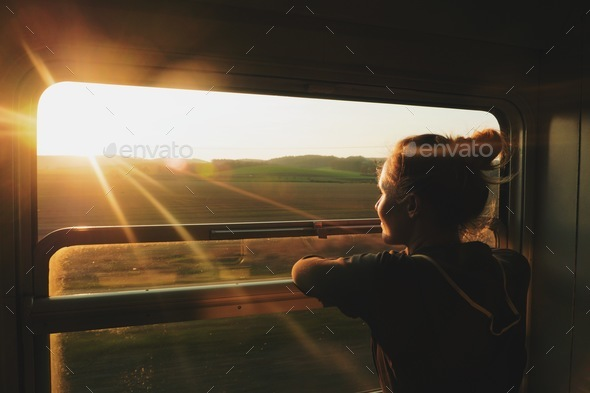 caucasian woman traveling by train - Stock Photo - Images