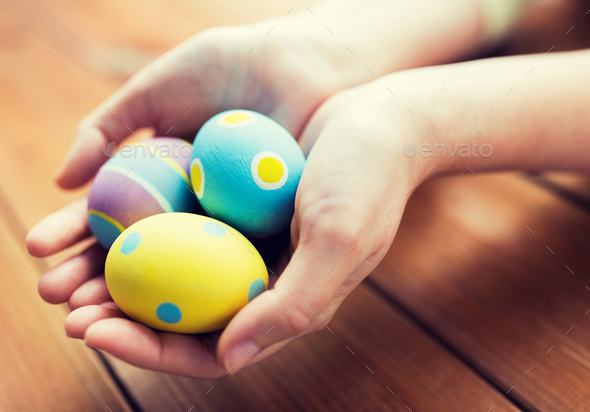 close up of woman hands with colored easter eggs - Stock Photo - Images
