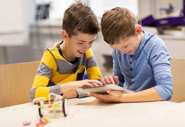 kids with tablet pc programming at robotics school - Stock Photo - Images