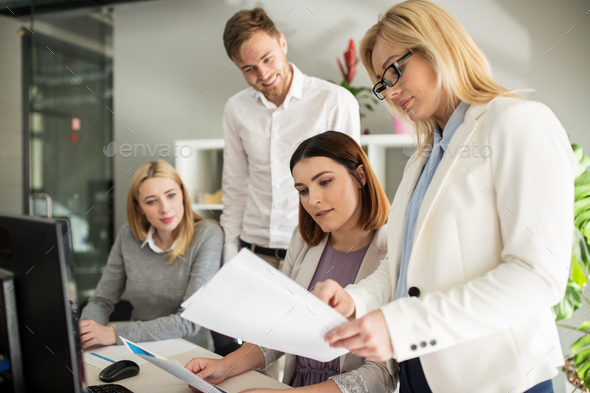 happy creative team with papers in office - Stock Photo - Images