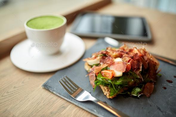 ham salad with matcha green tea at restaurant - Stock Photo - Images