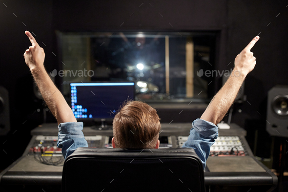 man at mixing console in music recording studio - Stock Photo - Images