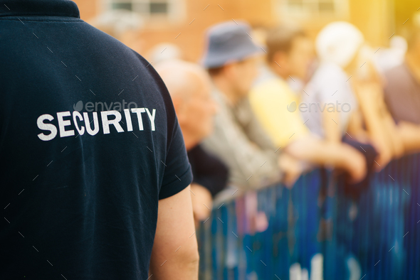 Member of security guard team on public event - Stock Photo - Images