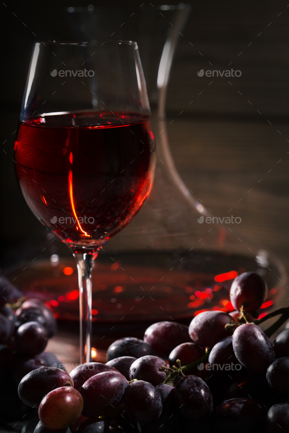 Glass of red wine and a bunch of grapes - Stock Photo - Images