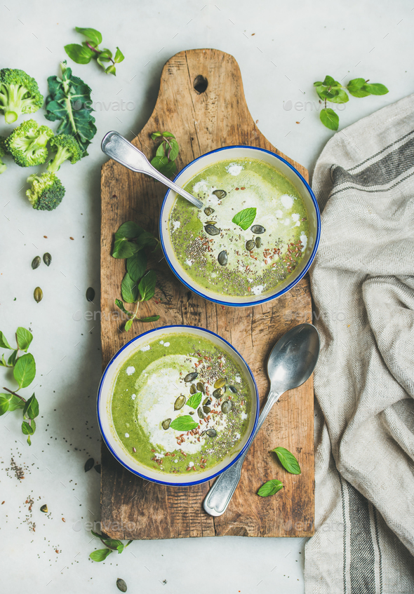 Spring vegetarian broccoli cream soup with mint and coconut cream - Stock Photo - Images