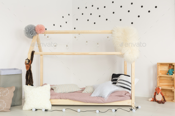 Wooden bed and soft accessories - Stock Photo - Images
