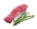 Raw striploin steak with rosemary
