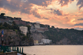 Cliff coast in Sorrento town at sunset