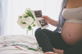 Pregnant woman looking at ultrasound scan of baby