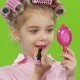 Little Girl in Pink Curlers Looks in the Mirror and Paints with Red Lipstick Lips. Green Screen. - VideoHive Item for Sale