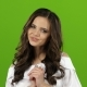 Brunette Shows a Finger Up Winks and Sends a Kiss. Green Screen. - VideoHive Item for Sale